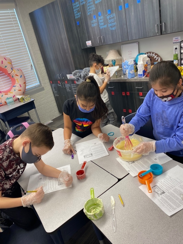 students baking cookies using fractions