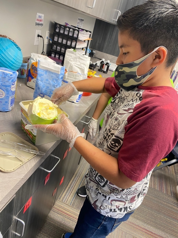 student baking cookies using fractions